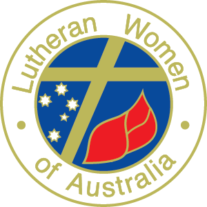 Logo of Lutheran Women of Australia – a circle containing a gold cross, the southern cross star formation and red flames of the Holy Spirit. The words, Lutheran Women of Australia are written in gold around the circle.