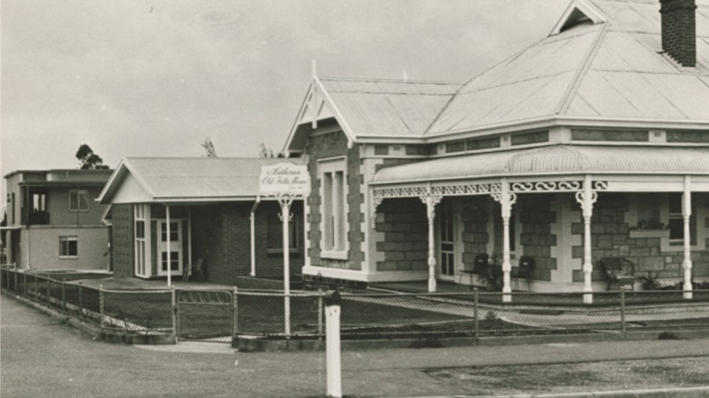 An old sandstone return verandah villa is pictured. The photo is sepia toned.