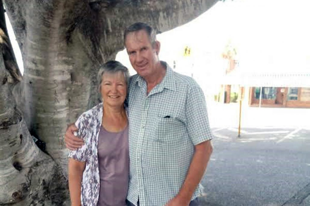 Neville and Cheryl Mirtschin stand in the shade of a large fig tree.